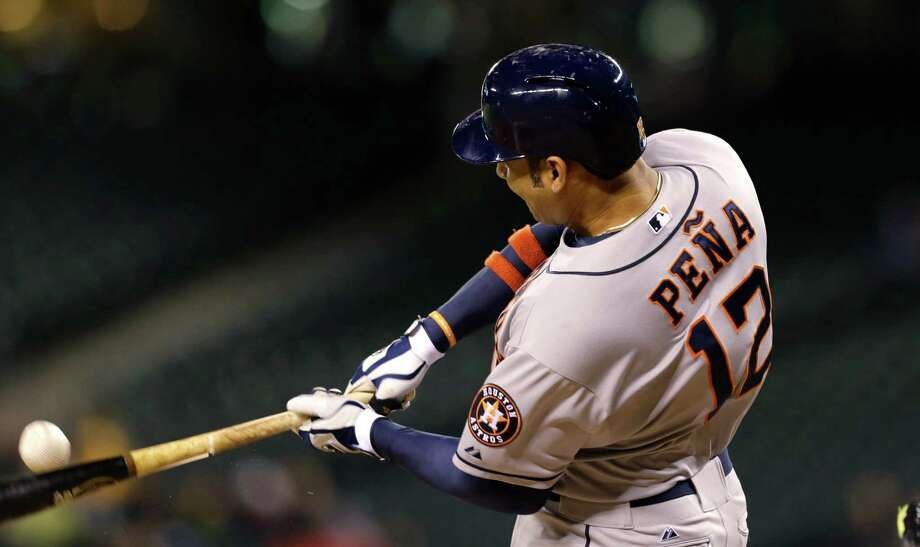 The Astros are hitting so much better the last two games that even their luck is turning, a la Carlos Pena's bat cracking but still producing a double. Photo: Elaine Thompson, STF / AP