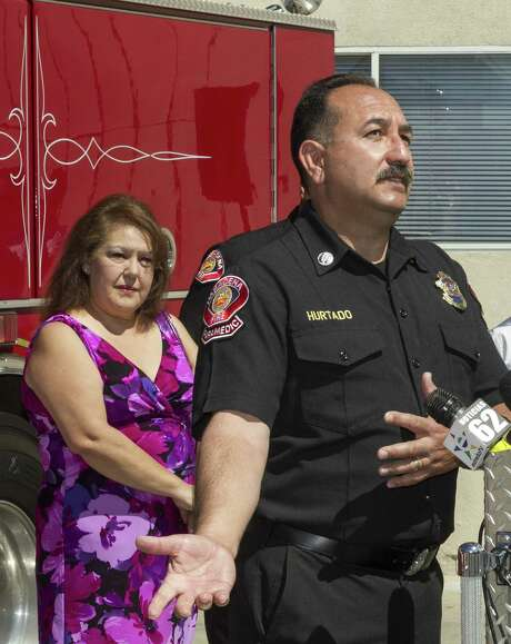 Pasadena Fire Capt. Art Hurtado, shown with his wife Isabel, helped save the life of a man at a Home Depot after the victim apparently tried to cut his arms off using handsaws. Photo: Damian Dovarganes / Associated Press