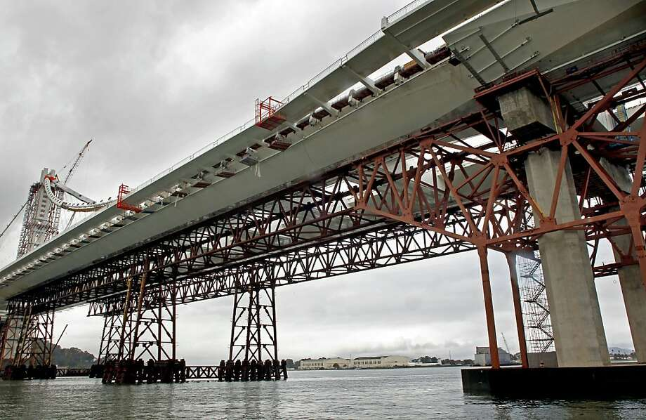 Pier E-2 (at right) contains the fractured anchor rods that Caltrans found on the new eastern section of the Bay Bridge. More than a third of the 96 rods used to seismically strengthen the span snapped when the nuts were tightened to hold them in place. Photo: Michael Macor, The Chronicle