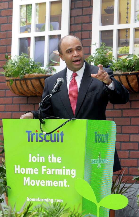 In this Tuesday, April 12, 2011 file photo Adolfo Carrion Jr., regional administrator of the U.S. Department of Housing and Urban Development, speaks at Triscuit Crackers 'Home Farming Day' celebration in New York's Madison Square Park. It sounds like a mismatch: a son of an illustrious Republican president supporting a Democrat-turned-independent, ex-Obama administration official in his quest to run for New York City mayor on the GOP line. But Michael Reagan is urging city Republican leaders to give Adolfo Carrion Jr. permission to run in the primary, saying it would strike a note of openness and diversity for a party that's grappling with how to attract Hispanic voters. (Jason DeCrow/AP Images for Kraft Foods) Photo: Jason DeCrow