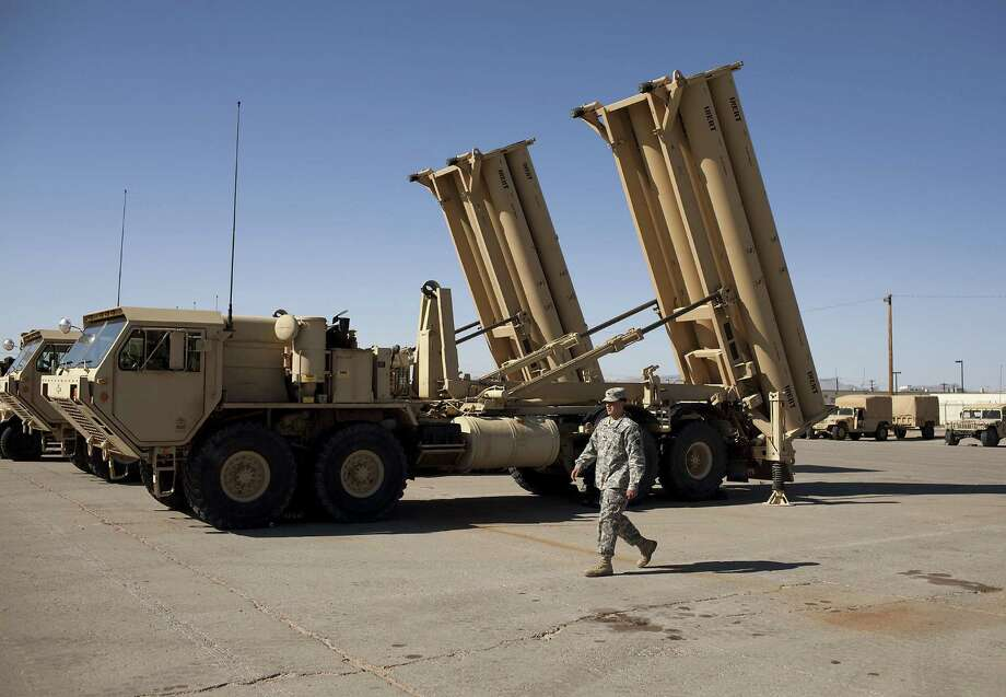 Two THAAD launchers in a parking lot at Fort Bliss. Another THAAD battery is poised to be deployed from the post to Guam. Photo: Ivan Pierre Aguirre / For The Express-News