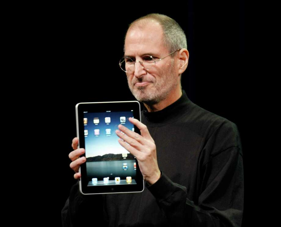 FILE - In this Jan. 27, 2010 file photo, Apple CEO Steve Jobs shows off the new iPad during an event in San Francisco. Imagine the potential treasures inside the stolen iPad of the late Steve Jobs, secret corporate documents, personal correspondence and maybe even game prototypes. Professional entertainer Kenny the Clown, who unwittingly received the stolen tablet after the Apple co-founder's Palo Alto home was burglarized last month, says he never examined the touch-screen device's contents.  The San Jose Mercury News says Kenny the Clown, whose real name is Kenneth Kahn, had no idea the iPad came from the Jobs residence until a friend who gave it to him was charged with burglary and police had confiscated the device. Authorities say 35-year-old Kariem McFarlin stole iPods, Macs, jewelry and Jobs' wallet. He is due in court Monday and recently hired a lawyer.  (AP Photo/Paul Sakuma, File) Photo: Paul Sakuma, STF / AP