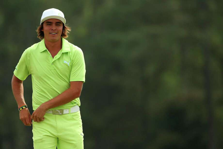 Rickie Fowler and his flat- brimmed hat were two shots behind.