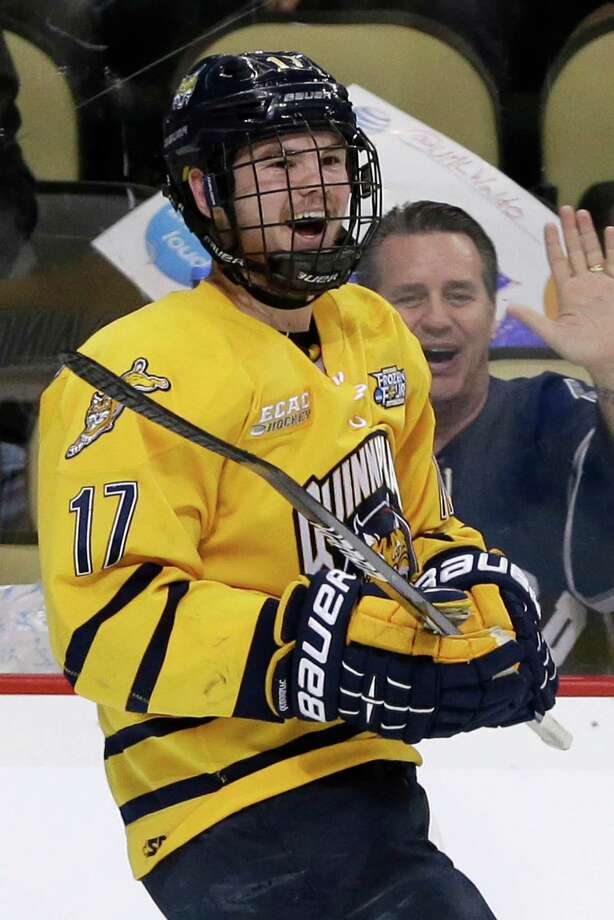Quinnipiac forward Jeremy Langlois (17) celebrates his first-period goal against St. Cloud St. during an NCAA college hockey game in Pittsburgh Thursday, April 11, 2013. (AP Photo/Gene J. Puskar) Photo: Gene J. Puskar, Associated Press / AP