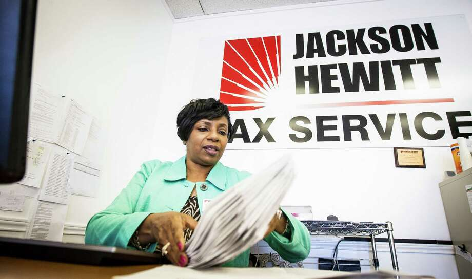 Shari Reece, an area manager for Jackson Hewitt, prepares a client's income tax return Thursday. Reece says this Friday through Monday will be very busy as the April 15 deadline approaches. Photo: Nick De La Torre, Staff / © 2013 Houston Chronicle