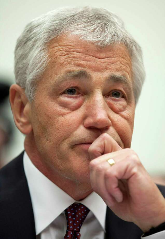 Defense Secretary Chuck Hagel pauses while testifying on Capitol Hill in Washington, Thursday, April 11, 2013, before the House Armed Services Committee hearing on the Defense Department's fiscal 2014 National Defense Authorization Budget Request. (AP Photo/Carolyn Kaster) Photo: Carolyn Kaster