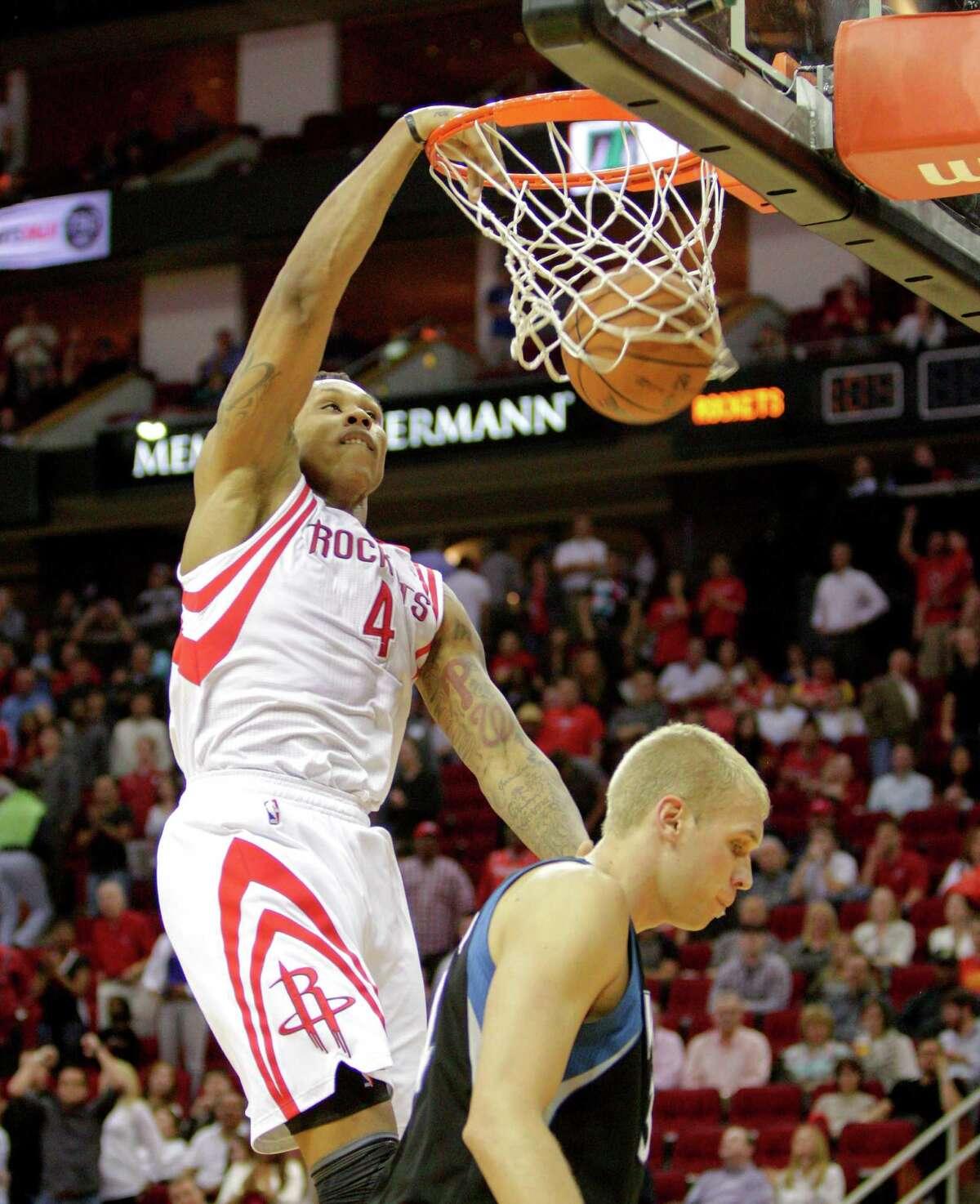 Houston Rockets power forward Greg Smith (4) dunks on Minnesota Timberwolves center Greg Stiemsma (34) during the second half of an NBA basketball game between the Minnesota Timberwolves and the Houston Rockets, Friday, March 15, 2013 in Houston. Houston won 108-100.