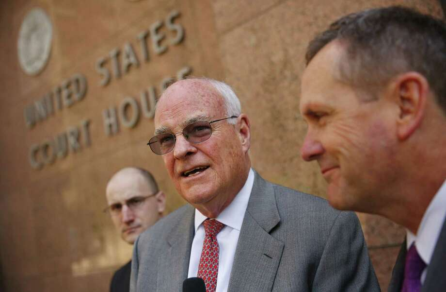 Attorneys Jay Ethington (center) and Michael McCrum (right) spoke on behalf of their client, former Dallas Cowboy Sam Hurd, who pleaded guilty to conspiracy in a Dallas federal court. Photo: Tom Fox / Dallas Morning News