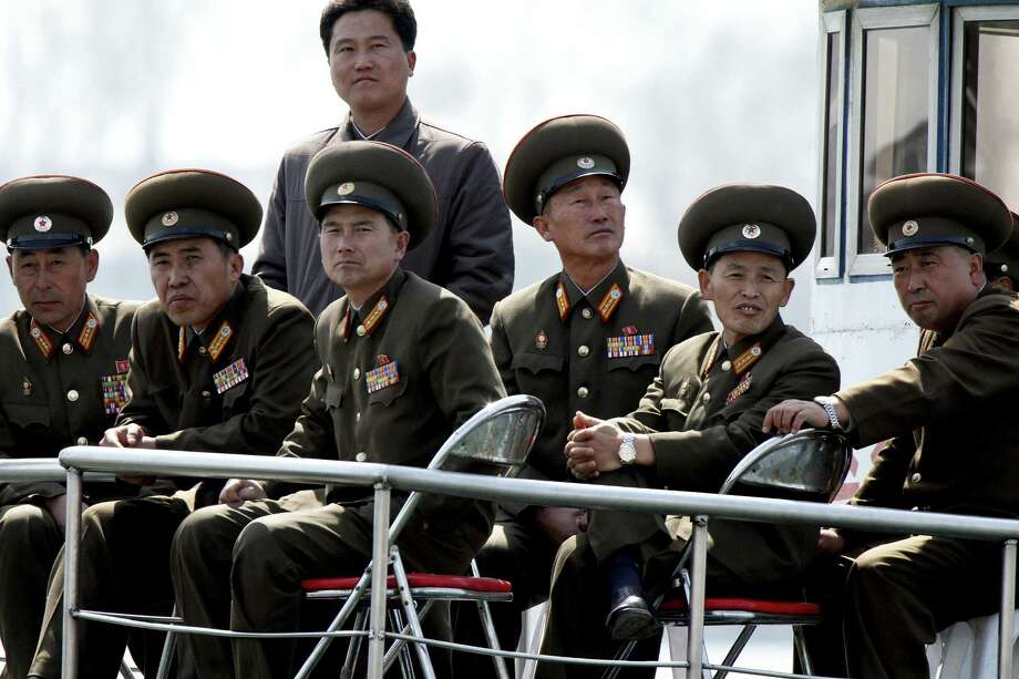 "North Korea, its military officers shown here, claims it has powerful nuclear striking means on standby for a missile launch, and the Pentagon expresses ""moderate confidence"" that's true. Photo: Associated Press"