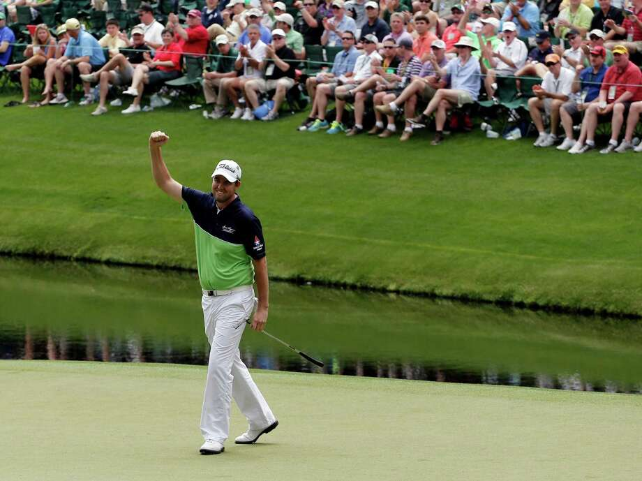 Marc Leishman, of Australia, reacts after a birdie on the 16th green during the first round of the Masters golf tournament Thursday, April 11, 2013, in Augusta, Ga. (AP Photo/Charlie Riedel) Photo: Charlie Riedel