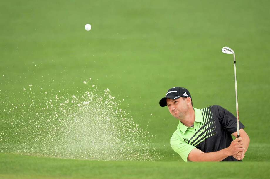 AUGUSTA, GA - APRIL 11:  Sergio Garcia of Spain hits out of a bunker on the second hole during the first round of the 2013 Masters Tournament at Augusta National Golf Club on April 11, 2013 in Augusta, Georgia.  (Photo by Harry How/Getty Images) Photo: Harry How