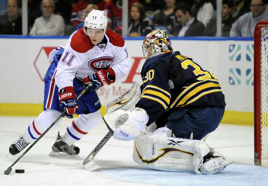 Montreal Canadiens right winger Brendan Gallagher (11) moves around Buffalo Sabres goaltender Ryan Miller (30) for a goal during the second period of an NHL hockey game in Buffalo, N.Y., Thursday, April 11, 2013. (AP Photo/Gary Wiepert) Photo: Gary Wiepert