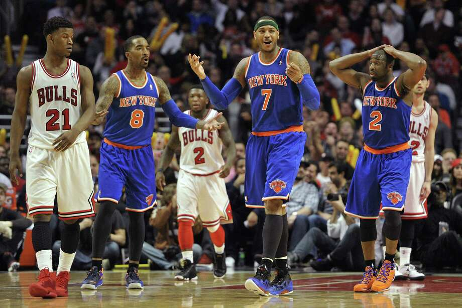 J.R. Smith (8), Carmelo Anthony (7) and Raymond Felton (2) of the Knicks react in disbelief to a play late in their game against the Bulls in Chicago. Photo: Jim Prisching / Associated Press