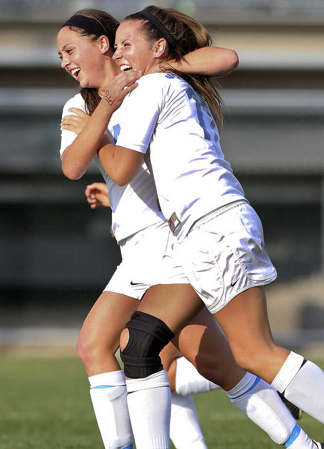 Caitlin Schwartz (left), Alyssa Clark and the Johnson Jaguars have recorded three straight shutouts in the playoffs, including beating MacArthur 3-0 on Tuesday. Photo: Photos By Tom Reel / San Antonio Express-News