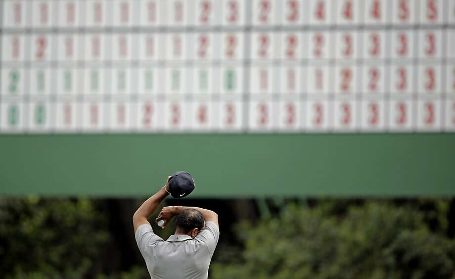 Tiger Woods wipes his forehead on the 11th green during the first round of the Masters golf tournament Thursday, April 11, 2013, in Augusta, Ga.  Photo: Matt Slocum, Associated Press
