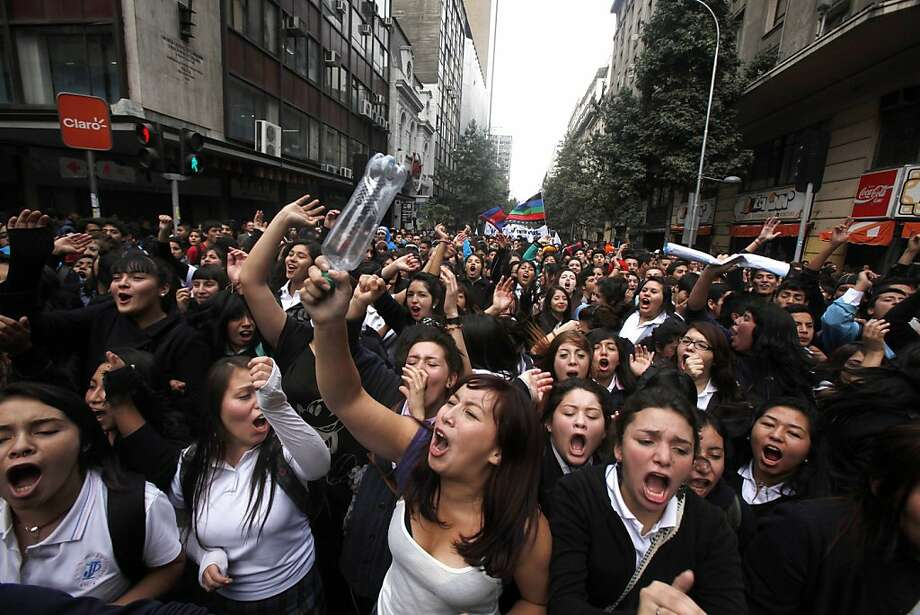 Chilean students march through the streets demanding free education, in Santiago, Chile, Thursday, April. 11, 2013.  The marches began during the 2006-2010 Michelle Bachelet administration and have troubled current President Sebastian Pinera even more. Pinera's government is focusing a chunk of the 2013 budget on financing school loans at lower rates. But students say the system still fails them, with poor public schools, expensive private universities, unprepared teachers and unaffordable loans.  Photo: Luis Hidalgo, Associated Press