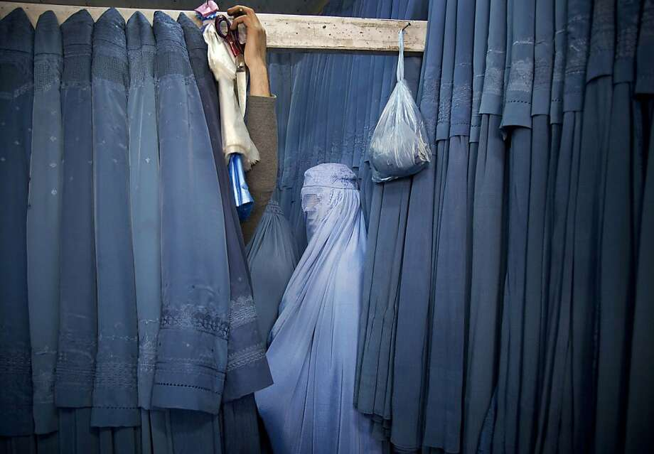 An Afghan woman waits in a changing room to try out a new Burqa, in a shop at in the old city of Kabul, Afghanistan, Thursday, April 11, 2013. Before the Taliban took power in Afghanistan, the Burqa was infrequently worn in cities. While they were in power, the Taliban required the wearing of a Burqa in public. Officially, it is not required under the present Afghan regime, but local warlords still enforce it in southern Afghanistan. Photo: Anja Niedringhaus, Associated Press