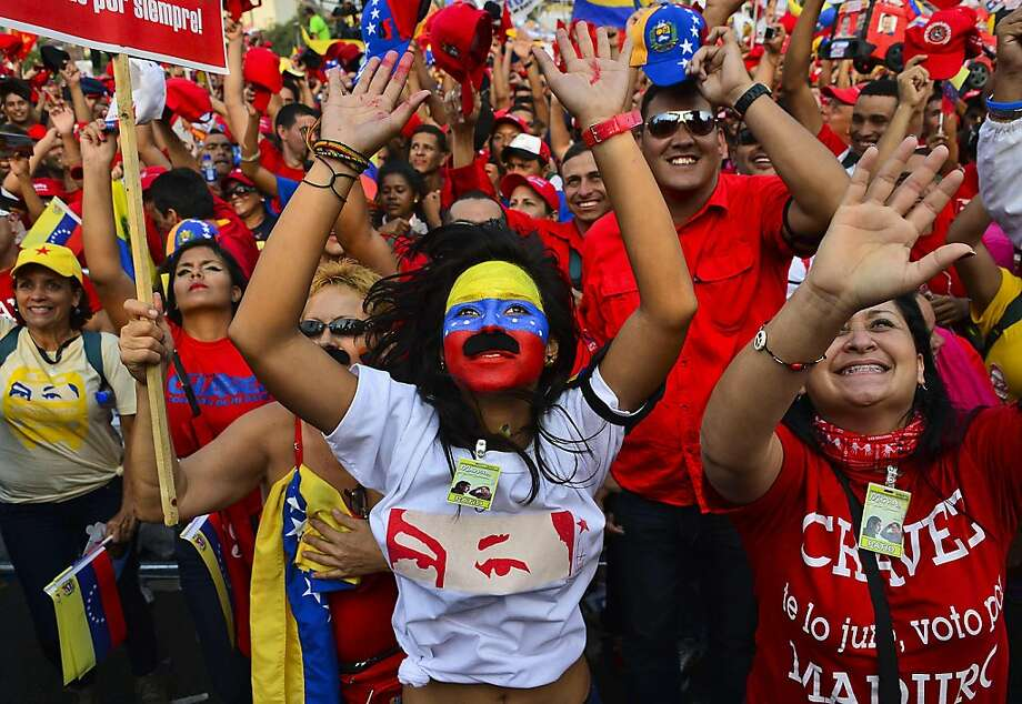 Supporters of  Venezuelan acting President and presidential candidate Nicolas Maduro cheer during his closing campaign rally in Caracas on April 11, 2013 ahead of the April 14th presidential election. Maduro and opposition rival Henrique Capriles held large closing rallies, ending a brief and bitter race to succeed Hugo Chavez on the anniversary of a failed coup against the late leader. Photo: Luis Acosta, AFP/Getty Images