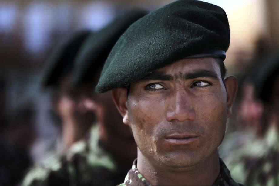 A newly recruited Afghan National Army soldier lines up with others during a graduation ceremony in Herat, Afghanistan, Thursday, April 11, 2013. 626 soldiers graduated during the ceremony after nine weeks of training. Photo: Hoshang Hashimi, Associated Press
