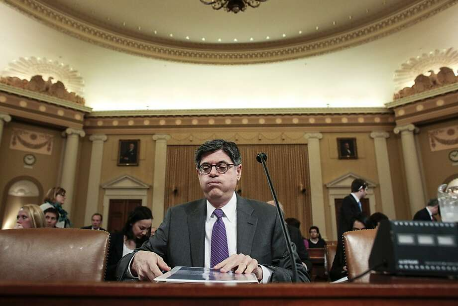 "Treasury Secretary Jack Lew takes his seat to testify before the House Ways and Means Committee on the president's fiscal year 2014 budget proposal on April 11, 2013 in Washington, DC. Lew cautioned that making budget cuts too soon could derail an economic recovery he described as ""fragile,"" referring to a House republican budget proposal that makes cuts earlier than the president's proposal. Photo: T.J. Kirkpatrick, Getty Images"