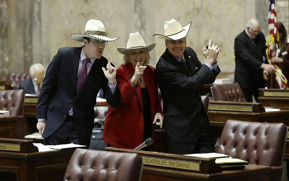 Washington Senators Joe Fain, from left, R-Auburn, Randi Becker, R-Eatonville, and  Steve Litzow, R-Mercer Island, all wearing cowboy hats pose for a Senate photographer on the Senate floor, Thursday, April 11, 2013, in Olympia, Wash. A resolution was later passed in the Senate recognizing National Day of the Cowboy and honoring men and women who live by traditional cowboy traits such as hard work, loyalty, and care of the land.  Photo: Ted S. Warren, Associated Press