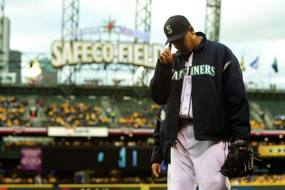 Mariners pitcher Felix Hernandez walks to dugout before a game against the Texas Rangers Thursday, April 11, 2013, at Safeco Field in Seattle. The Rangers beat the Mariners 4-3. The evening marked Felix Hernandez's opening game pitching at home for the 2013 season. The first 25,000 fans to arrive at Safeco Field were given discounted tickets and King Felix shirts. Photo: JORDAN STEAD / SEATTLEPI.COM