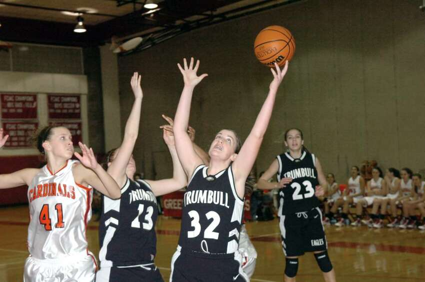 Trumbull's Erin Moore wins the rebound as Greenwich High School hosts Trumbull in a girls basketball game Tuesday evening, January 5, 2010. Trumbull won the game, 51-30.