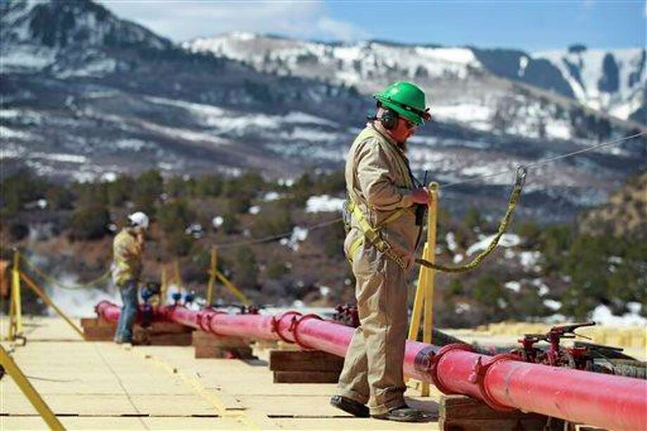 A worker helps monitor water pumping pressure and temperature, at the site of a natural gas hydraulic fracturing and extraction operation run by Encana Oil & Gas (USA) Inc., outside Rifle, in western Colorado. Proponents of hydraulic fracturing point to the economic benefits from vast amounts of formerly inaccessible hydrocarbons the process can extract. Opponents point to potential environmental impacts, with some critics acknowledging that some fracking operations are far cleaner than others. Photo: AP
