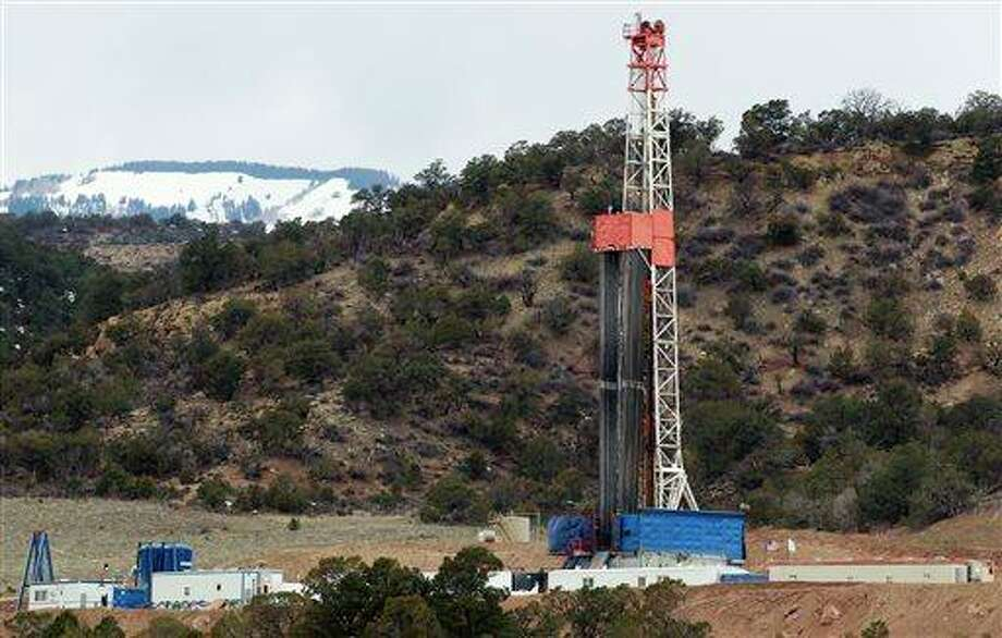 A rig drills for natural gas which will eventually be released using hydraulic fracturing, or fracking, on leased private property outside Rifle, in western Colorado. Once drilling is completed, wells are fractured to allow the flow of gas from deposits typically more than a mile underground. Photo: AP