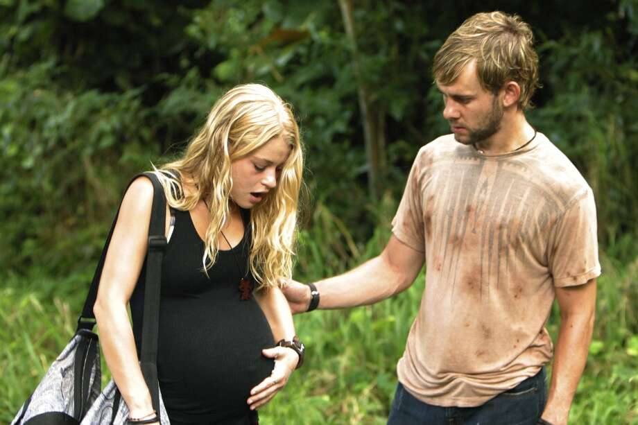 Emilie de Ravin, as Claire, is pictured with Dominic Monaghan, as Charlie.