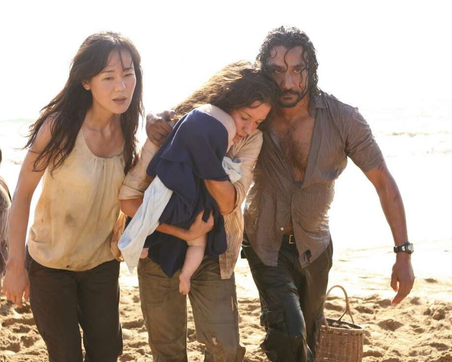 Yunjin Kim (left) played Sun, pictured with Evangeline Lilly as Kate and Naveen Andrews as Sayid.