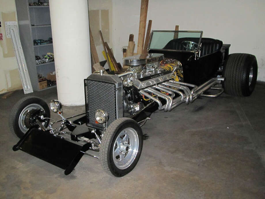 1923 Mathon V16 T-Bucket RoadsterThe V-16 in this 1923 Ford T-Bucket hot rod was built in the early 1990s by joining two Chevrolet 350 V-8s together at the crankshaft. Reportedly, just two of the monster motors were ever built, and this is the only one ever installed in a car.The folks at the Petersen Museum estimate the 700-cid V-16 produces 550 hp and 550 lb-ft of torque.   The Mathon is one of the wildest cars in the vault. It sits on an extremely stretched chassis to make room for the double-length engine. We can only imagine what this crazy engine sounds like when it's idling, much less at full throttle.Read more about the cars on Popular Mechanics Photo: Popular Mechanics