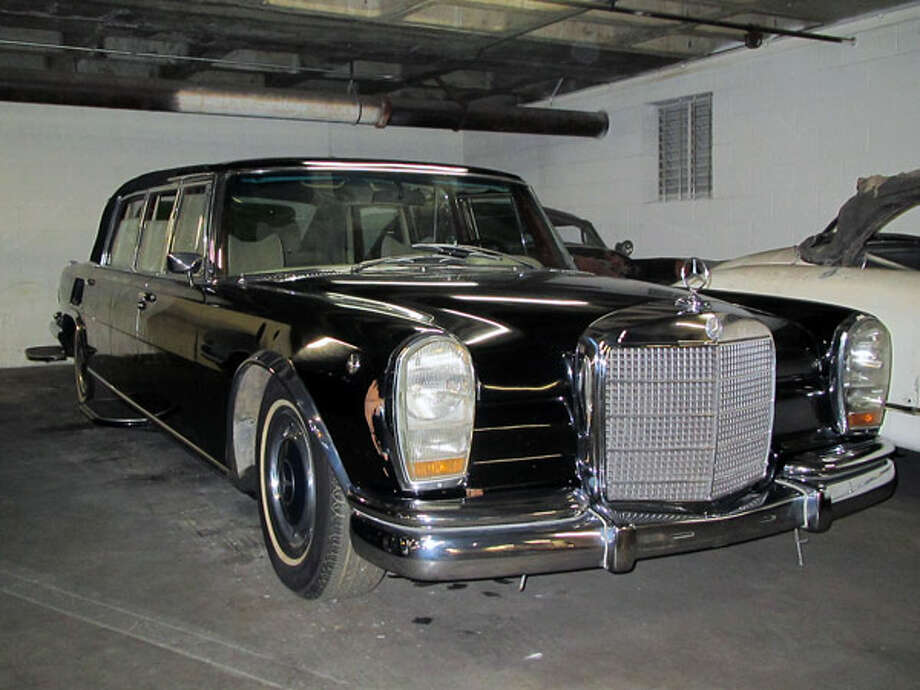 Saddam Hussein's 1978 Mercedes-Benz 600 LandauletBuilt from 1963 through 1981 in small numbers, Mercedes-Benz 600s were some of the finest and most advanced sedans of their time. The Landaulet versions of the cars were the most rare, and used primarily by heads of state. They had a solid roof above the driver and convertible tops that retracted upon the rest of the cabin so the crowds could see the passengers clearly as it drove by.The vents on the sides of the bodywork in the rear drew air for the air conditioner, which was installed in the trunk.   This dubious 600 belonged to Saddam Hussein until his overthrow in 2003. An Iraqi drove the beat-up Mercedes out of the country and eventually into Jordan. A Jordanian car collector who also lives in the U.S. pointed museum staff to the car's location at the Mercedes-Benz distributor in Jordan.   Why so many dents? Apparently, once the guards were through with their duties for the day they would sit on the trunk with their rifle butts on the metal.Read more about the cars on Popular Mechanics Photo: Popular Mechanics