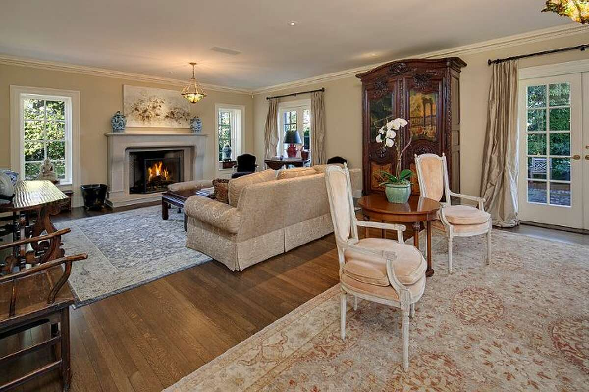 Living room of 1239 Shenandoah Drive E. The 7,500-square-foot Broadmoor Colonial, built in 1925, but extensively updated, has four bedrooms, 3.75 bathrooms, a family room, a den, a library, a theater, a gym, a game room, a play room, a wine cellar, three fireplaces, a three-car garage and a patio with a fountain on more than one-third of an acre. It's listed for $4.25 million.