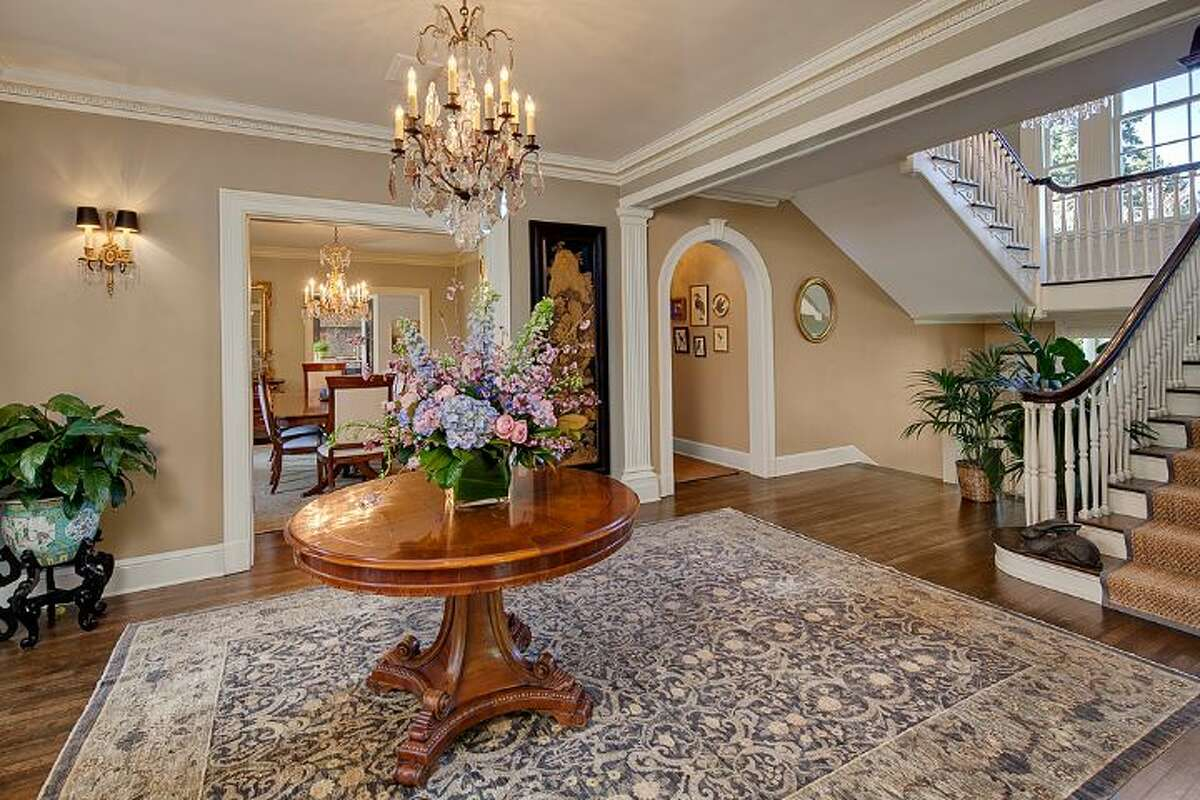 Foyer of 1239 Shenandoah Drive E. The 7,500-square-foot Broadmoor Colonial, built in 1925, but extensively updated, has four bedrooms, 3.75 bathrooms, a family room, a den, a library, a theater, a gym, a game room, a play room, a wine cellar, three fireplaces, a three-car garage and a patio with a fountain on more than one-third of an acre. It's listed for $4.25 million.
