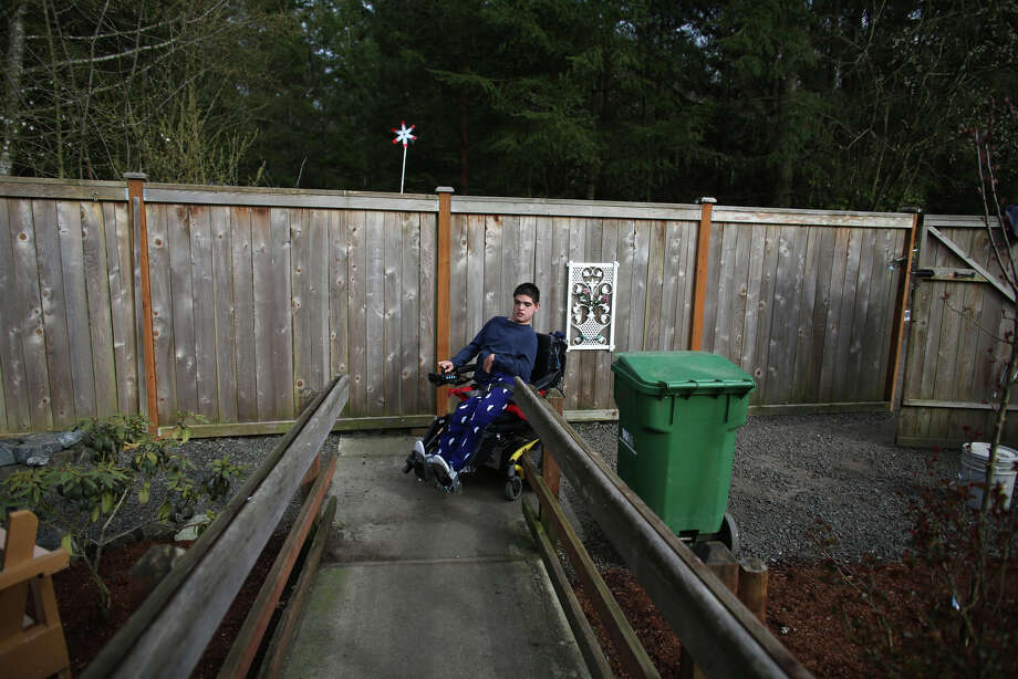 Terry Hoefer rolls up a ramp at his home near Gig Harbor. Photo: JOSHUA TRUJILLO, SEATTLEPI.COM / SEATTLEPI.COM