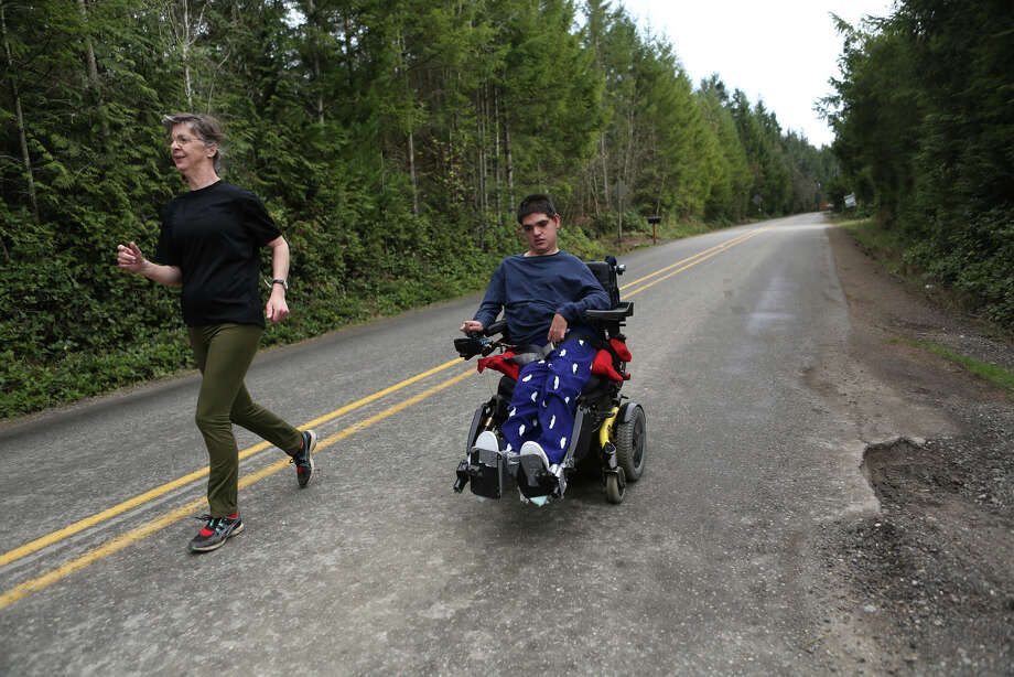 Vickie Hoefer, left, runs alongside her son Terry Hoefer in his 