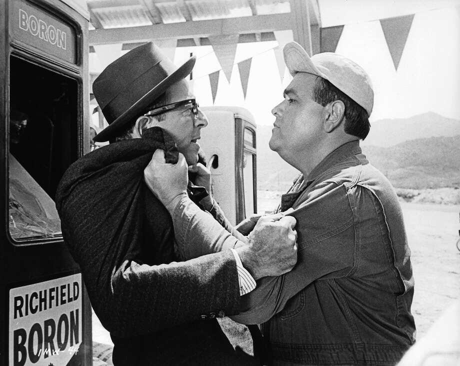 Phil Silvers and Jonathan Winters gripping each other in a scene from the film 'It's A Mad Mad Mad Mad World', 1963. Photo: Archive Photos, Getty Images / 2012 Getty Images