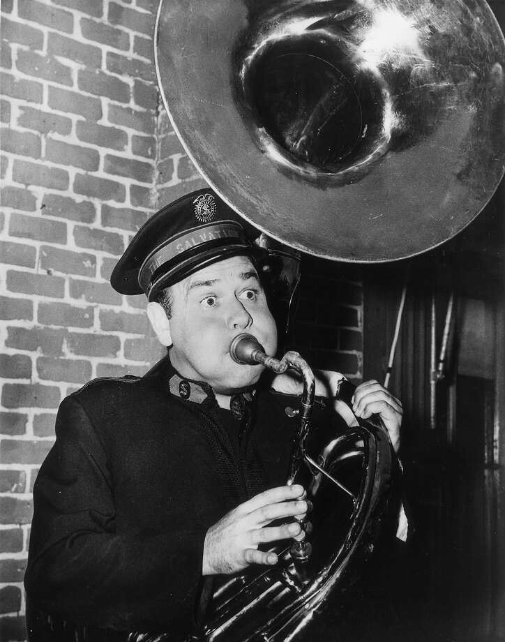 Dressed in a Salvation Army uniform and playing a tuba, actor-comic Jonathan Winters known as 'America's Jimmy Edwards' as he will appear in his latest film comedy with Rosalind Russell, 'Oh Dad, Poor Dad, Mamma's Hung You In The Closet and I'm Feeling So Sad'. Photo: Fox Photos, Getty Images / Hulton Archive