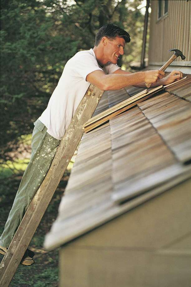 Inspect the roof at least once a year, paying attention signs of premature aging such as shingles crumbling and/or missing. Photo: Comstock / Comstock Images