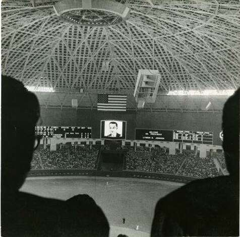 The Astrodome scoreboard lit up in 1965 to welcome President Lyndon Baines Johnson to the world's first indoor baseball game. Photo: Curtis McGee, Houston Chronicle