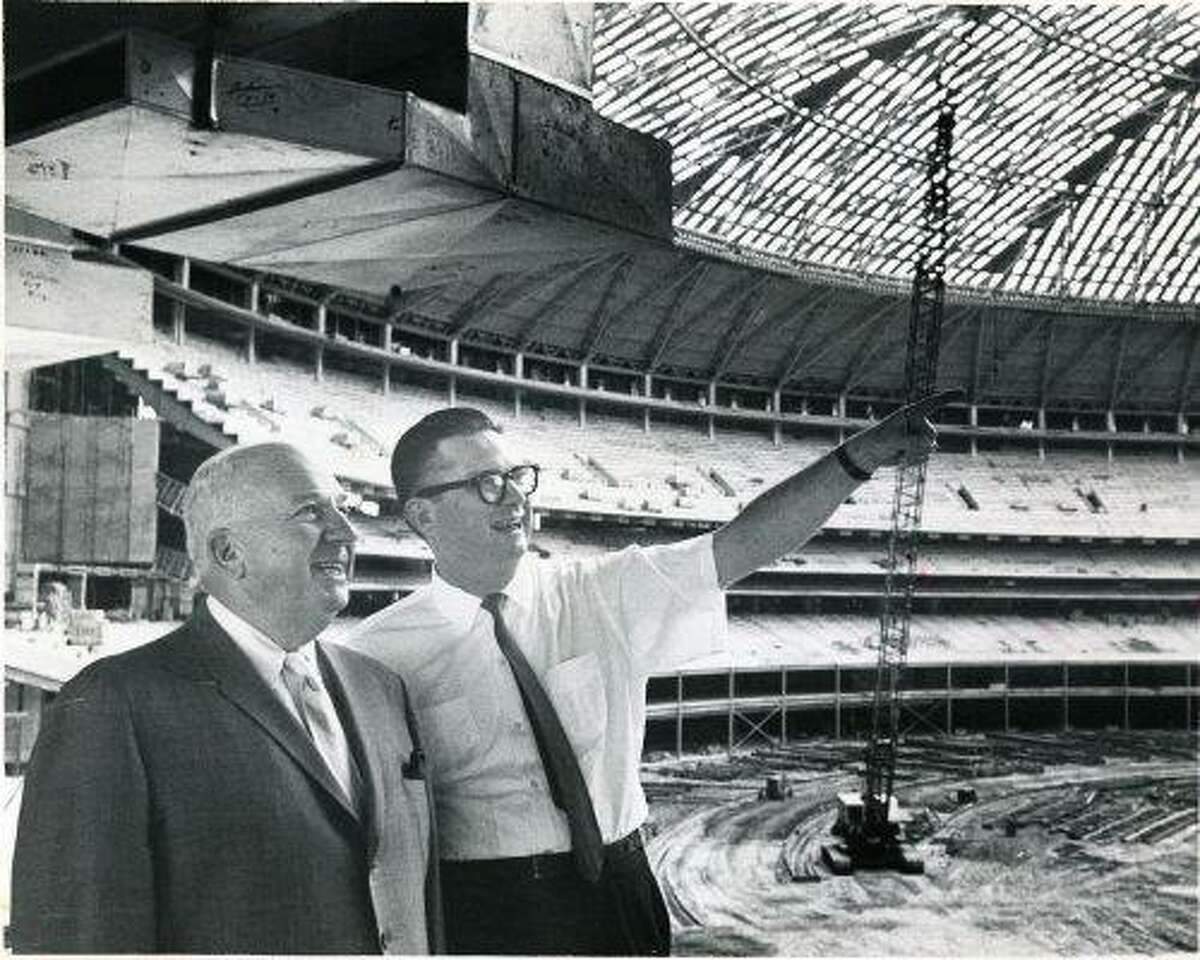Colt .45 President Roy Hofheinz, right, shows National League president Warren Giles some features of the Astrodome in September 1964.
