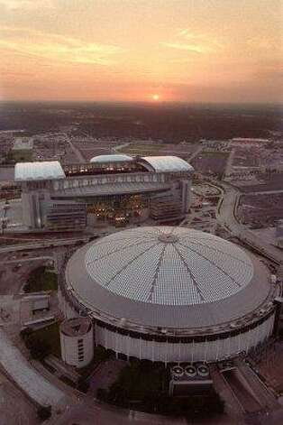 In this Aug. 2, 2002 file photo, an aerial view of Reliant Stadium, the new home of the Houston Texans and the Astrodome, former home of the Houston Oilers is shown in Houston. Photo: Smiley N. Pool, Houston Chronicle