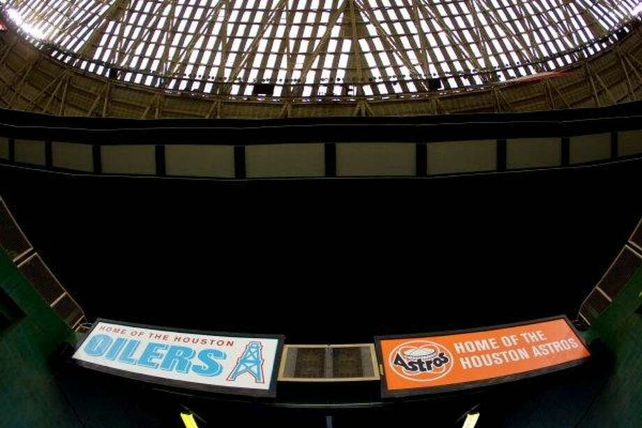 Vintage logos of yesteryear decorate the Reliant Astrodome in 2010. Photo: Nick De La Torre, Houston Chronicle