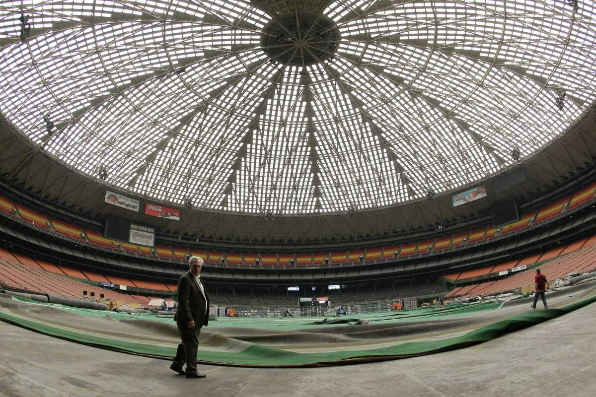 Mark Miller, left, general manger of Reliant Park, lead a media tour of the Reliant Astrodome Tuesday, April 3, 2012, in Houston.