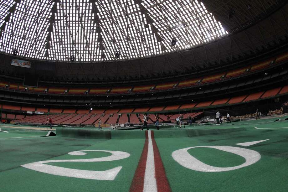 Damaged Astro Turf is seen stretched across the floor of Reliant Astrodome Tuesday, April 3, 2012, in Houston. Photo: Melissa Phillip, Houston Chronicle / © 2012 Houston Chronicle