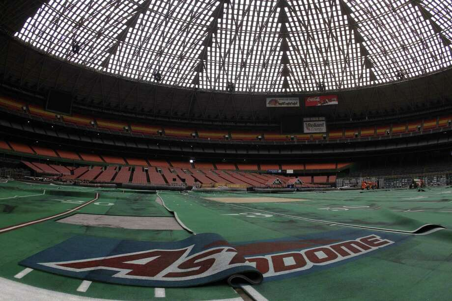 Damaged Astro Turf is stretched across the floor inside of Reliant Astrodome Tuesday, April 3, 2012, in Houston. Photo: Melissa Phillip, Houston Chronicle / © 2012 Houston Chronicle