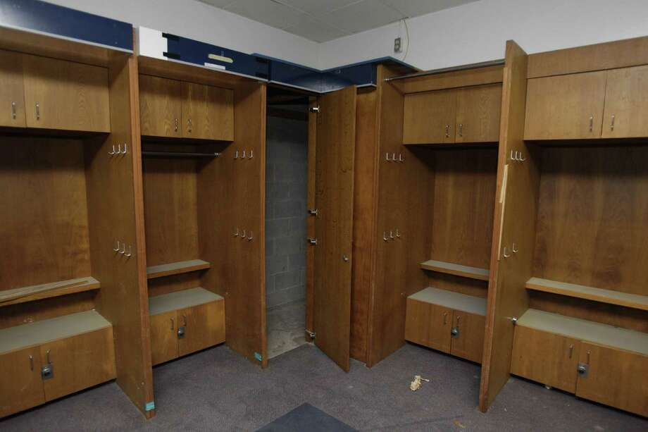 Locker room area formerly used by the Houston Astros at Reliant Astrodome shown Tuesday, April 3, 2012, in Houston. The two center lockers were used once by Nolan Ryan. Photo: Melissa Phillip, Houston Chronicle / © 2012 Houston Chronicle