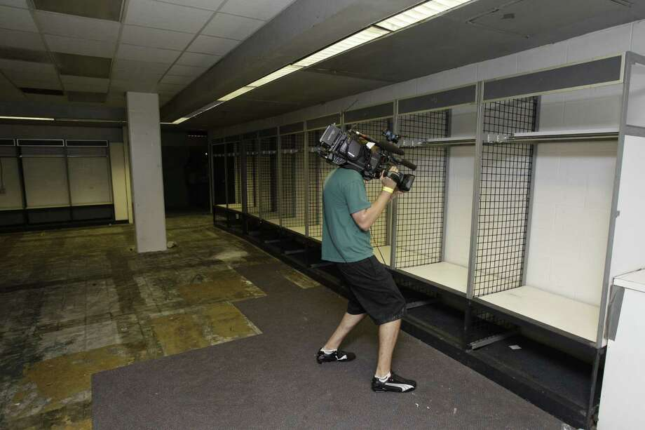 View of the former Houston Oilers' locker room area seen in Reliant Astrodome Tuesday, April 3, 2012, in Houston. The locker on the right was once used by Oilers' quarterback Warren Moon. Photo: Melissa Phillip, Houston Chronicle / © 2012 Houston Chronicle