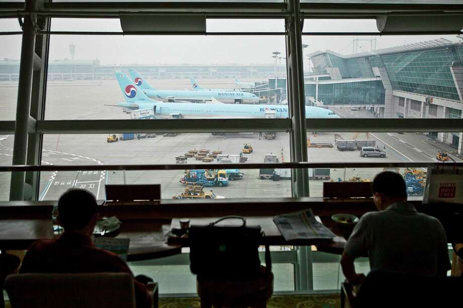 Passengers sit inside the Korean Air Lines Co. first class lounge as the company's aircraft stand on the tarmac at Incheon International Airport in Incheon, South Korea, on Friday, April 5, 2013. Korean Air, which counts Samsung Electronics Co. as its biggest source of revenue, expects passenger demand to increase 3.9 percent this year as economic growth in the U.S. and Asia, help mask a downturn in European demand. Photographer: Jean Chung/Bloomberg Photo: Jean Chung, Bloomberg / © 2013 Bloomberg Finance LP